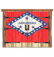 closed barn door with arkansas state flag