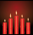 realistic red glowing candles with melted wax vector image