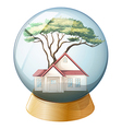 A crystal ball with a house and a tree inside vector image vector image