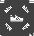 Running shoe icon sign Seamless pattern on a gray vector image