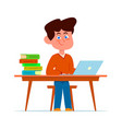 boy at school desk in classroom smiling vector image