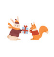 funny rabbit in warm clothes giving gift box to vector image vector image