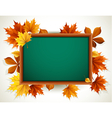 wooden blackboard with autumn leaves vector image