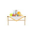 food on table with sweet cupcakes and milk in pack vector image vector image