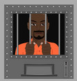 african american man looking from behind bars vector image vector image