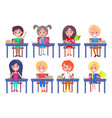set of schoolchildren sitting at desks isolated vector image vector image