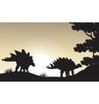 Silhouette of two stegosaurus scenery vector image vector image