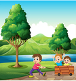 Boys playing at the riverbank vector image vector image