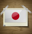 Flags Japan at frame on wooden texture vector image vector image