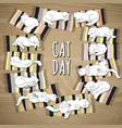 cat day card cat on a striped mat vector image vector image