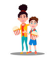 boy and girl with popcorn in hands vector image