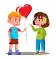 little boy gives the girl red heart balloon vector image