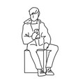 man sitting on cube with can of soda or other soft vector image vector image