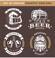 set of vintage brewery emblems on dark background vector image