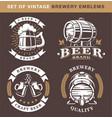 set vintage brewery emblems on dark background vector image