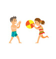 children on beach throwing ball boy and girl vector image