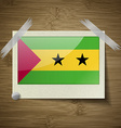 Flags Sao Tome Principe at frame on wooden texture vector image vector image