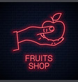 hand hold apple neon sign male holding red apple vector image vector image
