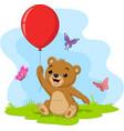 cartoon little bear holding red balloon vector image vector image