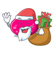 santa with gift ellipse mascot cartoon style vector image