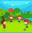 four children playing football in the park vector image vector image