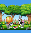 happy easter bunnies painting and holding egg vector image vector image