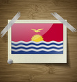 Flags Kiribati at frame on wooden texture vector image vector image
