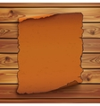 Old orange scroll on wooden planks vector image vector image
