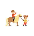cute little boy jockey sitting on pony horse vector image vector image