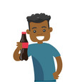 young african-american man holding bottle of soda vector image vector image