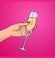 female hand holding glass champagne wine pop art vector image vector image