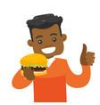 young african-american man eating hamburger