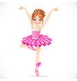 ballerina girl in pink tutu dancing on one leg