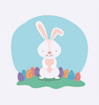 cute rabbit with easter eggs painted in the camp vector image