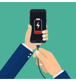 hand holds a phone with a low battery charge vector image vector image