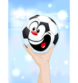 happy winner - soccer ball in hand lifting the vector image vector image