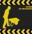 WORK IN PROGRESS sign with worker carries a vector image