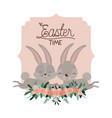 easter time frame with bunnies couple and ornament vector image vector image