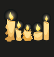 Set of candles isolated on a black backgrounds vector image vector image
