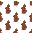 seamless pattern chocolate bunny with pink ribbon vector image