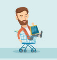 happy man riding in shopping trolley vector image vector image