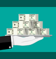 stack dollar banknotes on tray in hand vector image