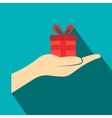 Small gift red box in a hand flat icon vector image vector image
