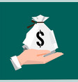 hand holding a money bag vector image vector image