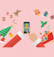 santa claus sending gift using smartphone with vector image