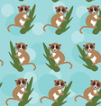 Seamless pattern lemur on green branch on blue vector image