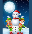 cartoon christmas elves with snowman in the winter vector image vector image