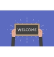 Hand holding sign welcome vector image vector image