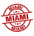 miami red round grunge stamp vector image vector image