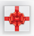 gift box with a red bow tied flight top view of a vector image vector image